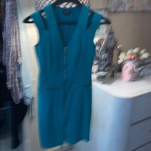 Green,  form fitting zippered dress.